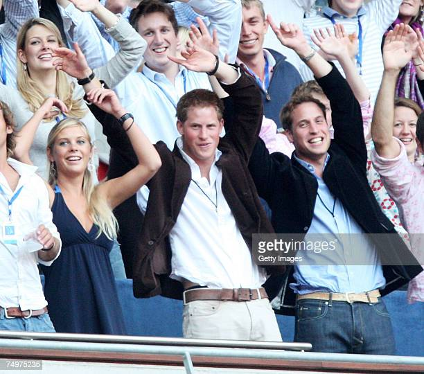 Their Royal Highnesses Prince William and Prince Harry and guest Chelsy Davy watch Rod Stewart perform during the Concert for Diana at Wembley...