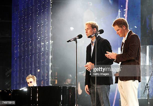 Their Royal Highnesses Prince William and Prince Harry speak on stage with Sir Elton John at the piano at the Concert for Diana at Wembley Stadium on...