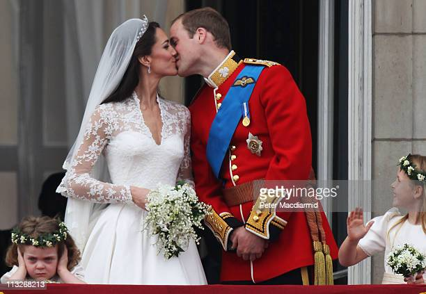 Their Royal Highnesses Prince William, Duke of Cambridge and Catherine, Duchess of Cambridge kiss on the balcony at Buckingham Palace on April 29,...