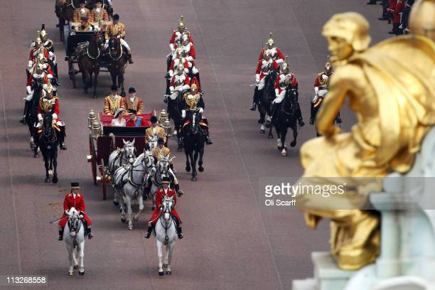 Their Royal Highnesses Prince William Duke of Cambridge and Catherine Duchess of Cambridge travel along the Mall following their marriage ceremony on...