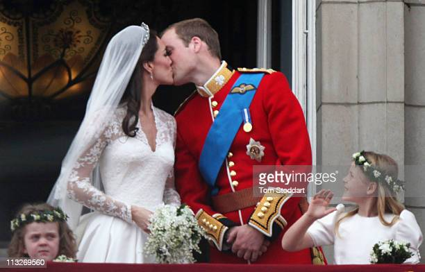 Their Royal Highnesses Prince William Duke of Cambridge and Catherine Duchess of Cambridge kiss on the balcony at Buckingham Palace on April 29 2011...