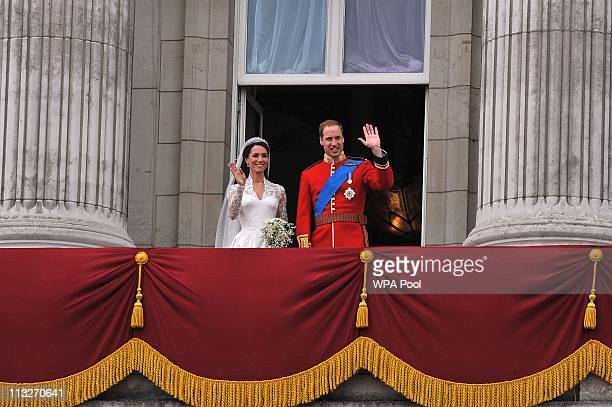Their Royal Highnesses Prince William Duke of Cambridge and Catherine Duchess of Cambridge wave on the balcony at Buckingham Palace during the Royal...