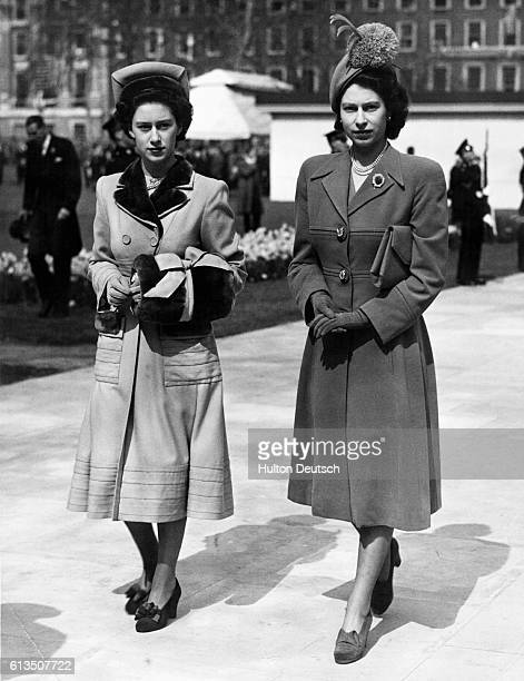 Their royal highnesses Princess Margaret and Princess Elizabeth walk side by side after leaving the unveiling ceremonies of the memorial statue to...