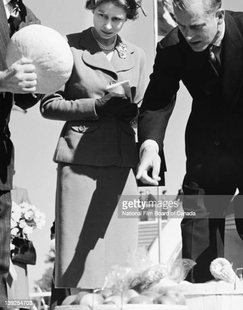 Their Royal Highnesses the Princess Elizabeth and Prince Philip Duke of Edinburgh are shown some of Canada's finest vegetables in Windsor Ontario...
