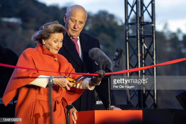 Their Royal Majesties Queen Sonja and King Harald cut the ribbon at the official opening of the MUNCH museum on October 22, 2021 in Oslo, Norway.