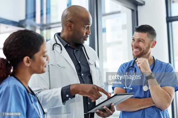 their schedules are all planned out online - group of doctors stock pictures, royalty-free photos & images