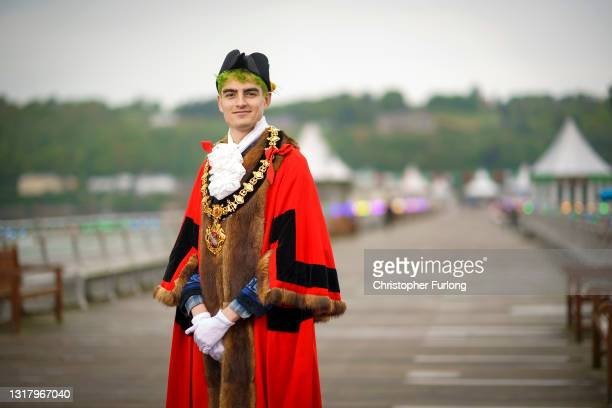 Their Worship The Mayor of Bangor, Owen J Hurcum, poses for pictures at Bangor Pier on May 14, 2021 in Bangor, Wales. Newly elected Mayor of Bangor,...