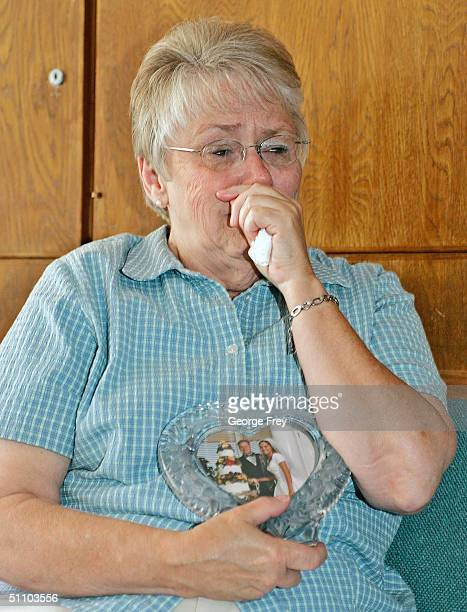 Thelma Soares cries during an interview as she holds wedding pictures of her daughter Lori Hacking July 21 2004 in Salt Lake City Utah Hacking who is...