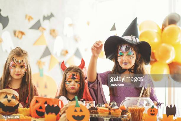 thematic kids party - devil costume stock photos and pictures