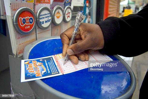 Themba Nyoni a teacher at Barbican College selects his numbers for Friday night's EuroMillions draw Thursday February 2 2006 The payoff in tomorrow's...