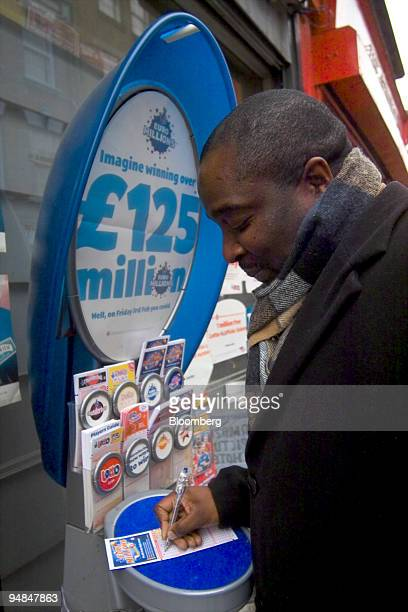 Themba Nyoni, a teacher at Barbican College selects his numbers for Friday night's EuroMillions draw, Thursday, February 2, 2006. The payoff in...