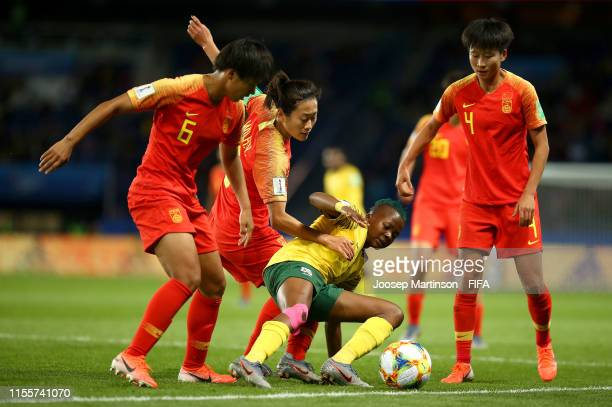 Thembi Kgatlana of South Africa is challenged by Haiyan Wu of China and Jiahui Lou of China during the 2019 FIFA Women's World Cup France group B...