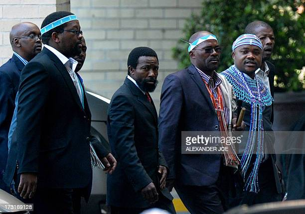 Thembu King Buyelekhaya Dalindyebo flanked by chiefs arrives on July 9 2013 to visit former South African President Nelson Mandela at the MediClinic...