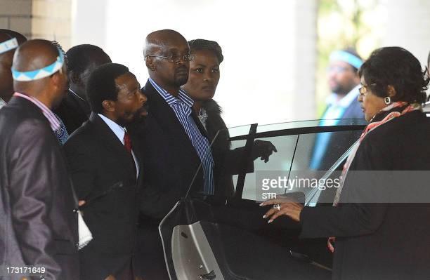 Thembu King Buyelekhaya Dalindyebo flanked by members of the Thembu royal house speaks with antiapartheid campaigner Winnie MadikizelaMandela the...