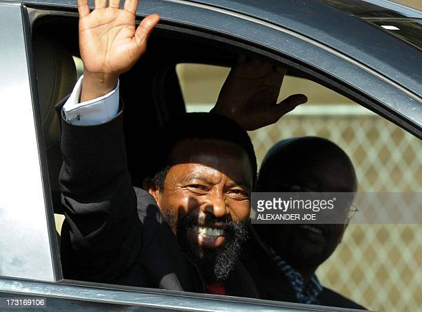 Thembu King Buyelekhaya Dalindyebo waves to the media as he arrives on July 9 2013 to visit former South African President Nelson Mandela at the...