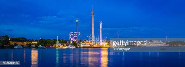 theme park fairground rides illuminated tivoli grona lund stockholm sweden - djurgarden stock pictures, royalty-free photos & images