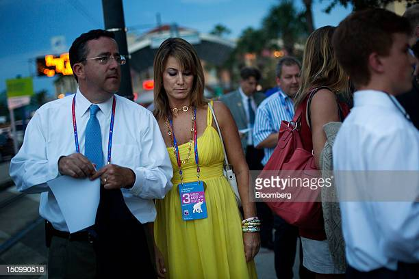 Themis Klarides a delegate from Derby Connecticut center waits to enter the Tampa Bay Times Forum on the third day of the Republican National...