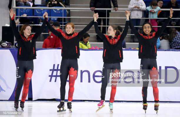Then team of Canada with Danae Blais Kim Boutin Alyson Charles and Camikllke de SerresRainville celebrates winning the third place of the ladies 3000...