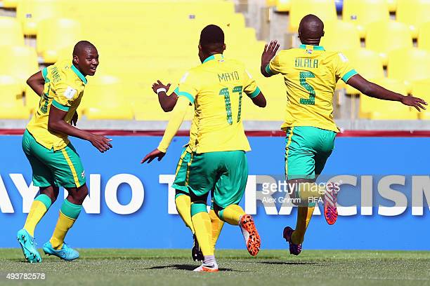 Thendo Mukumela of South Africa celebrates his team's first goal with team mates during the FIFA U17 World Cup Chile 2015 Group E match between South...