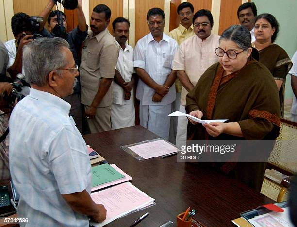 Chief Minister of the Indian state of Tamil Nadu and General Secretary of AIADMK party J Jayalalithaa is watched by an election offical as she reads...