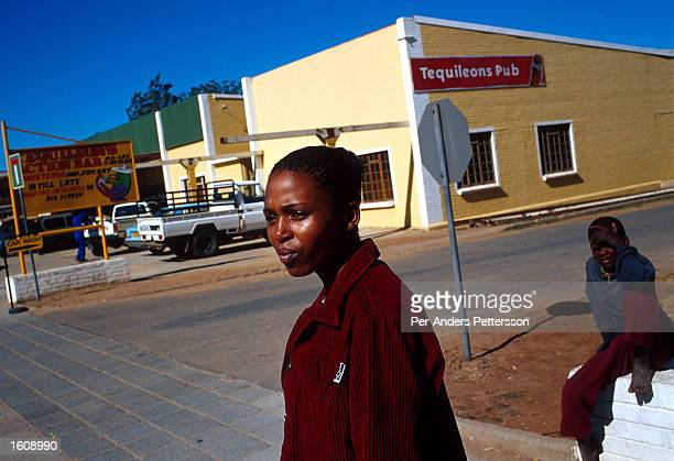 Thenjiwe Bosman a 24year old worker for the African National Congress passes the Tequileons Pub a whites only bar June 20 2001 in Vryburg South...
