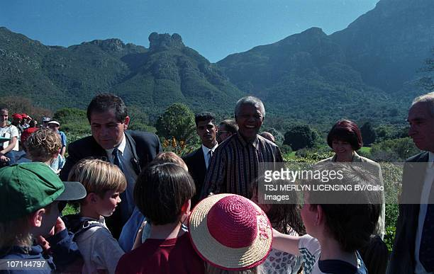 ThenPresident Nelson Mandela at Kirstenbosch Botanical Gardens in August 1996 with a specially cultivated hybrid of the crane flower Strelitzia...