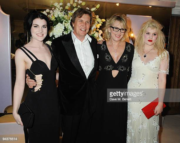 Theo and Louise Fennell with their daughters Coco and Emerald attend the Grey Goose Character Cocktails Winter Fundraiser Ball in aid of the Elton...
