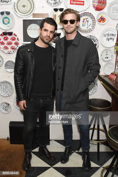 Theo Battaglia and model RJ King attend the Oliver Peoples Pour Berluti Launch Celebration at Sant Ambroeus SoHo on March 28 2017 in New York City