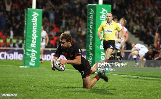 Theo Belan of Lyon scores a second half try during the European Rugby Challenge Cup match between Lyon and Sale Sharks at Matmut Stade de Gerland on...