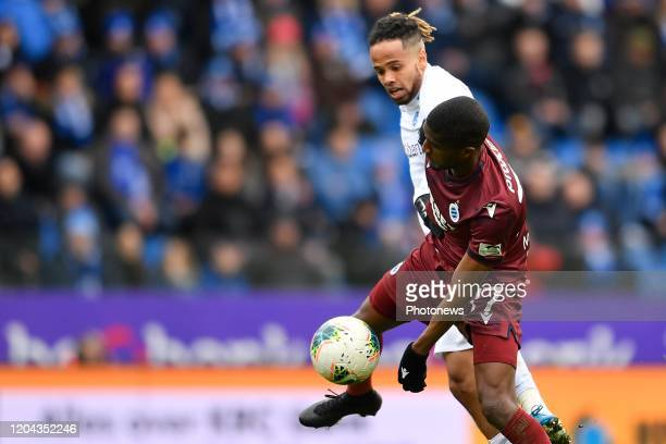 Theo Bongonda forward of Genk battles for the ball with Clinton Mata defender of Club Brugge during the Jupiler Pro League match between KRC Genk and...