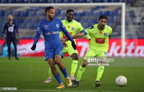 Theo Bongonda of KRC Genk battles for the ball with Milad Mohammadi of KAA Gent during the Jupiler Pro League match between KRC Genk and KAA Gent at...
