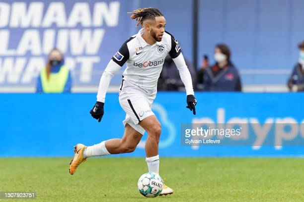 Theo Bongonda of KRC Genk runs with the ball during the Jupiler Pro League match between Club Bruges and KRC Genk at Jan Breydel Stadium on January...