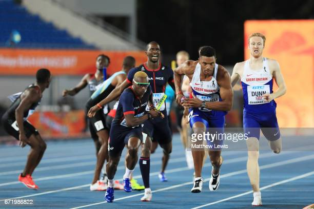 Theo Campbell of Great Britain and Thomas Jordier of France compete in heat one of the Men's 4 x 400 Relay during the IAAF/BTC World Relays Bahamas...