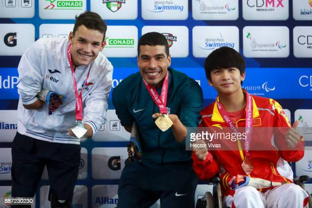 Theo Curin of France Daniel Dias of Brazil and Li Jusheng of Chine pose after the Men's 200m Freestyle S5 Final during day 5 of the Para Swimming...