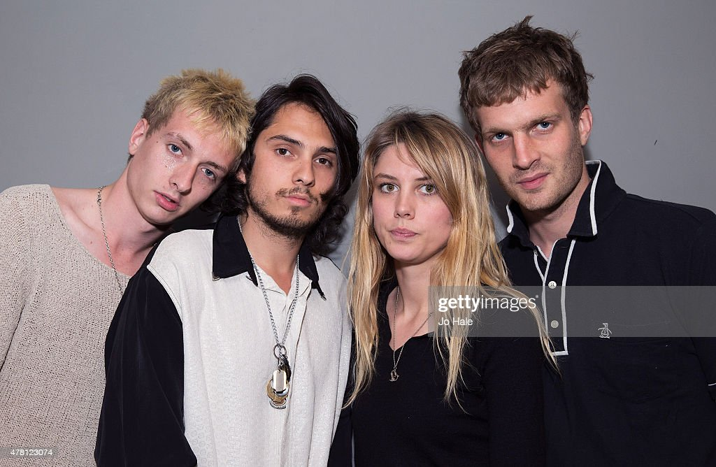 Theo Ellis, Joel Amey, Ellie Rowsell and Joff Oddie of Wolf Alice pose backstage prior to their live stage performance and signing copies of their debut album 'My Love Is Cool' at HMV, Oxford Street on June 22, 2015 in London, United Kingdom