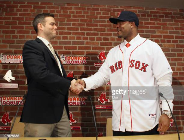Theo Epstein general manager of the Boston Red Sox welcomes Carl Crawford to the team during a press conference to announce Crawford's signing on...