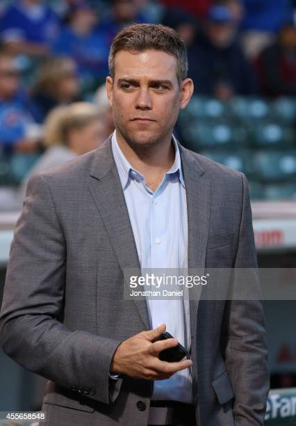 Theo Epstein President of Baseball Operations for the Chicago Cubs waits to participate in a ceremony before a game between the Cubs and the...