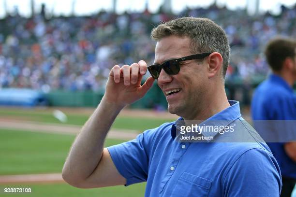 Theo Epstein President of Baseball Operations for the Chicago Cubs looks on prior to the spring training game against the Boston Red Sox at JetBlue...