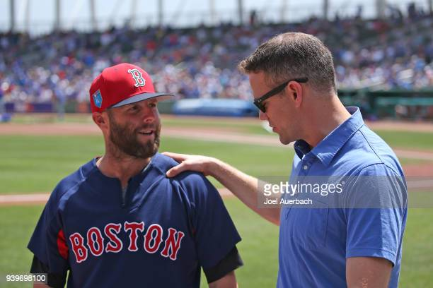 Theo Epstein President of Baseball Operations for the Chicago Cubs talks to Dustin Pedroia of the Boston Red Sox prior to a spring training game at...