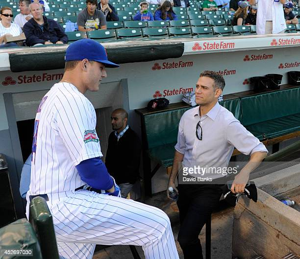 Theo Epstein President of Baseball Operations of the Chicago Cubs and Anthony Rizzo of the Chicago Cubs before a game between the Chicago Cubs and...