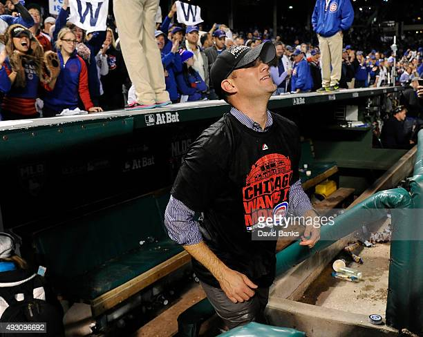 Theo Epstein President of baseball operations of the Chicago Cubs leaves the dugout to celebrate the Cubs win against the St Louis Cardinals 64 in...