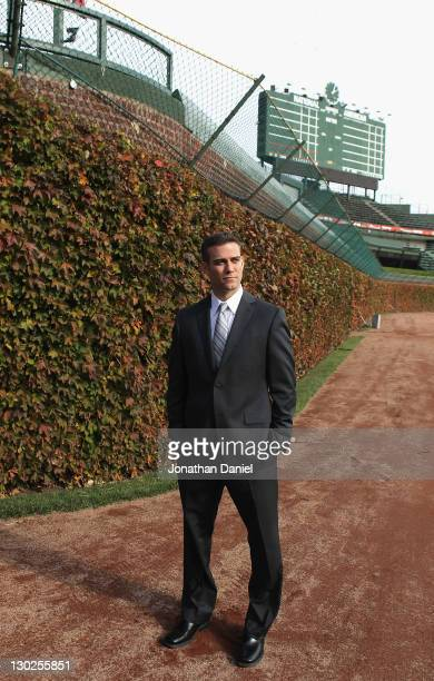 Theo Epstein the new President of Baseball Operations for the Chicago Cubs poses in the outfield following a press conference at Wrigley Field on...