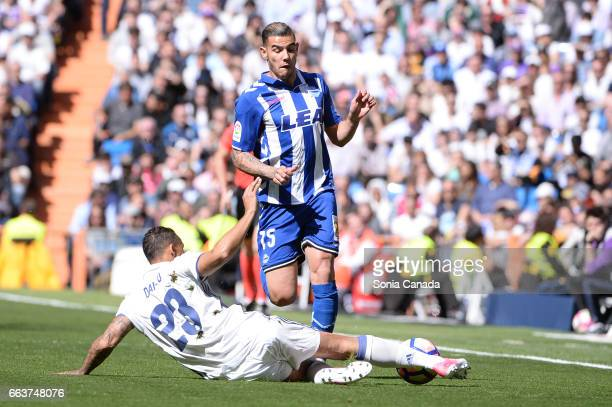 Theo Hernandez #15 of Deportivo Alaves and Danilo #23 of Real Madrid during the La Liga match between Real Madrid CF v Deportivo Alaves at Santiago...