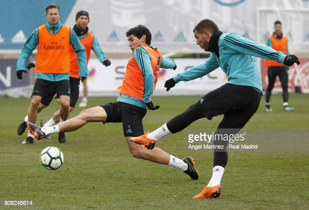 Theo Hernandez and Jesus Vallejo of Real Madrid in action during a training session at Valdebebas training ground on March 2 2018 in Madrid Spain