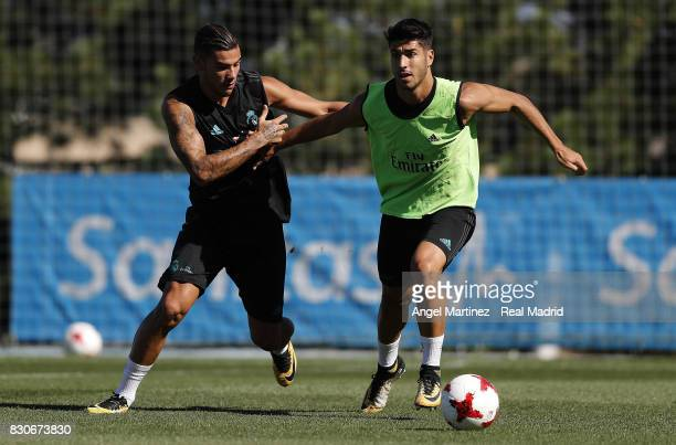Theo Hernandez and Marco Asensio of Real Madrid in action during a training session at Valdebebas training ground on August 12 2017 in Madrid Spain