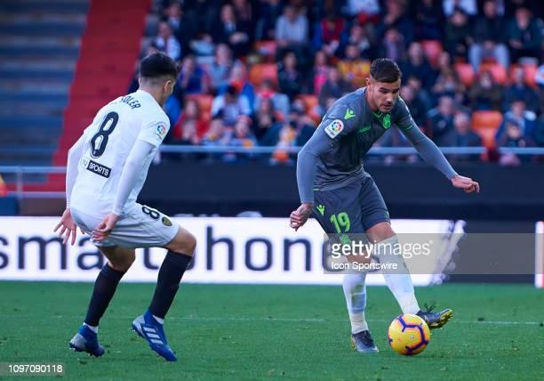 Theo Hernandez defender of Real Sociedad and Carlos Soler midfielder of Valencia CF looks during the La Liga match between Valencia CF and Real...