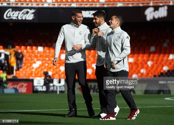 Theo Hernandez Lucas Vazquez and Marco Asensio of Real Madrid react prior to the La Liga match between Valencia and Real Madrid at Estadio Mestalla...