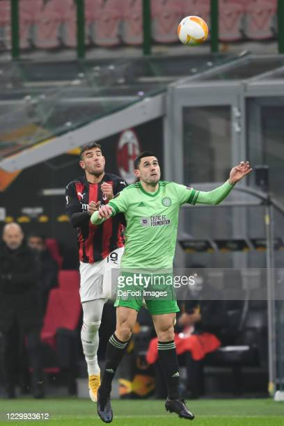 Theo Hernandez of AC Milan and Mikey Johnston of FC Celtic Glasgow battle for the ball during the UEFA Europa League Group H stage match between AC...