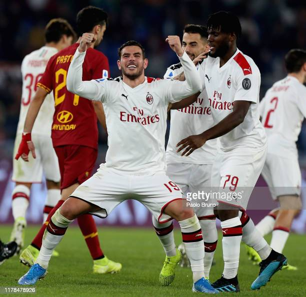 Theo Hernandez of AC Milan celebrates after scoring the team's first goal during the Serie A match between AS Roma and AC Milan at Stadio Olimpico on...