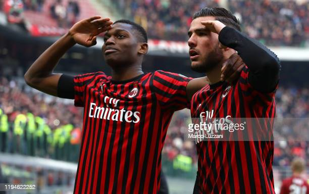 Theo Hernandez of AC Milan celebrates his goal with his teammate Rafael Leao during the Serie A match between AC Milan and Udinese Calcio at Stadio...